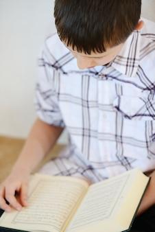 Muslim kid reading koran