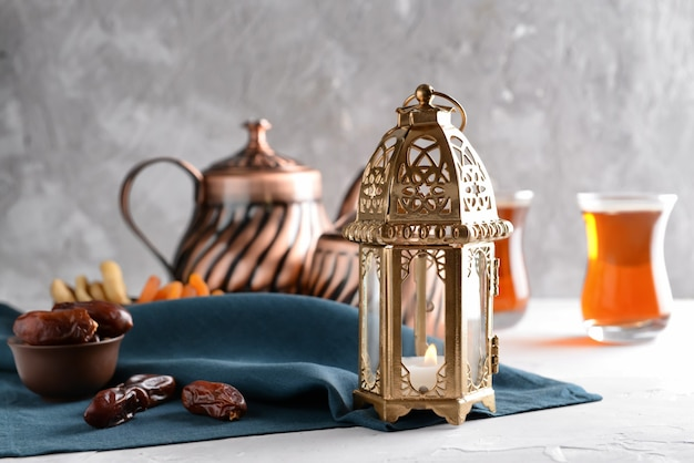 Muslim lantern with dried dates on table