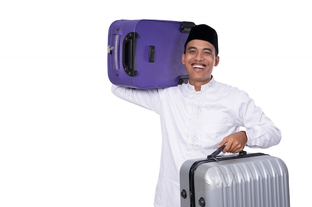 Muslim male carrying suitcase for eid mubarak celebration