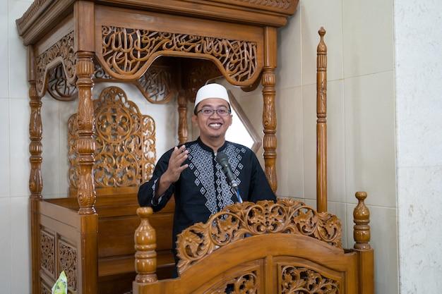Muslim male preacher sharing about islam