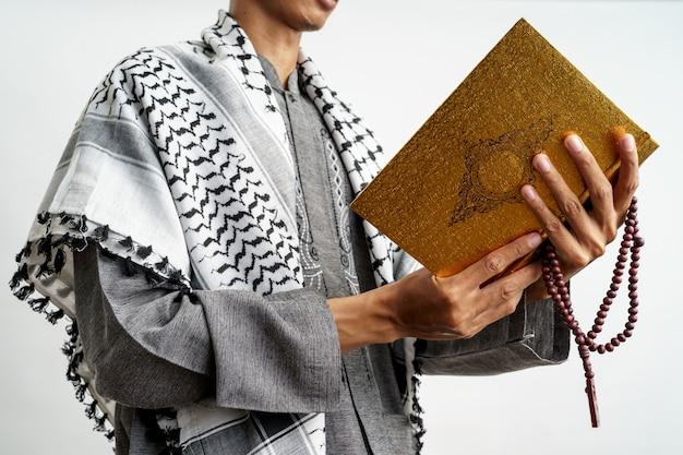 Muslim male reading quran