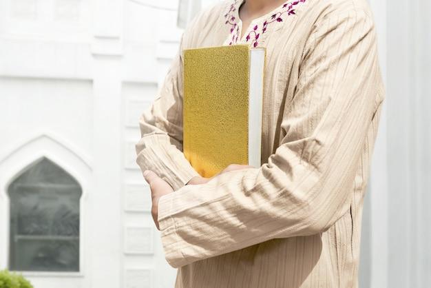 Muslim man holding quran