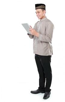 Muslim man holding tablet pc