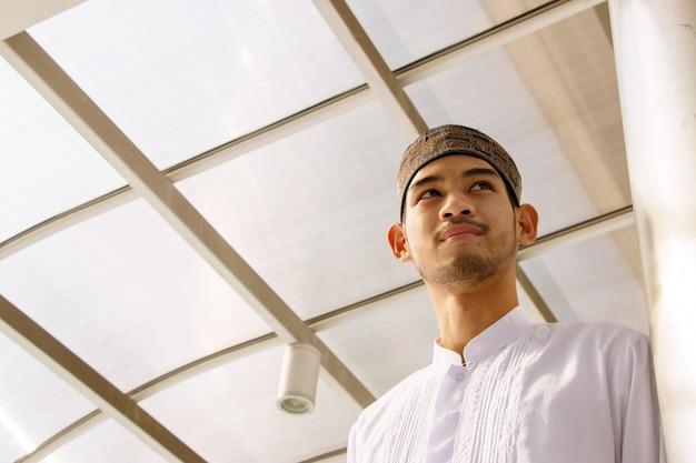 Muslim man is standing.