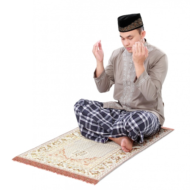 Muslim man praying on carpet
