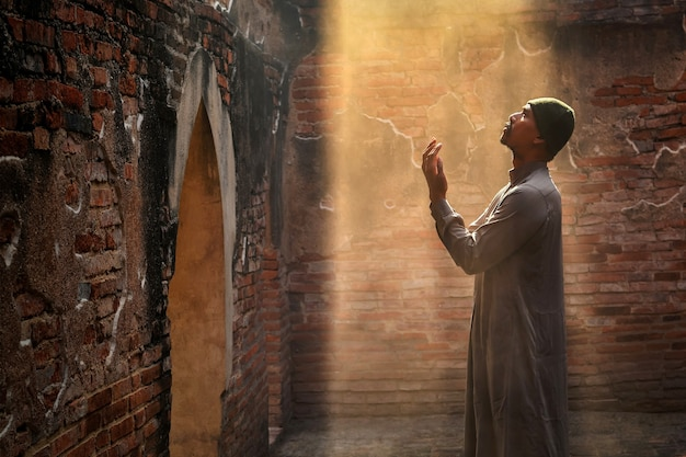 Muslim man praying at an old mosque in phra nakhon si ayutthaya province, thailand, asian muslims