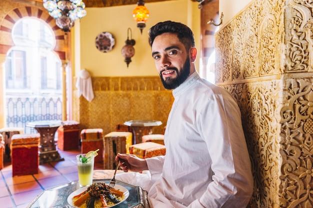 Muslim man sitting in restaurant