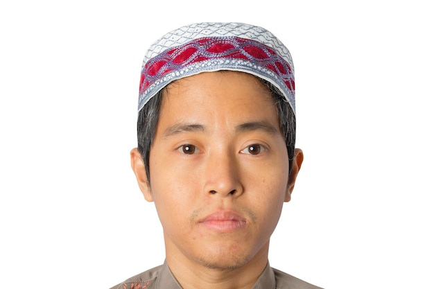Muslim man wearing kopiah hat isolated on white background. clipping path.