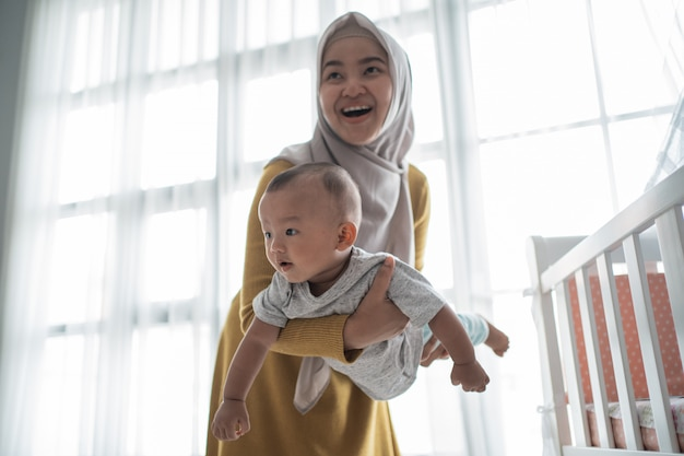 Muslim mother play with her child