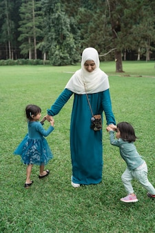 Muslim mother plays with her two children