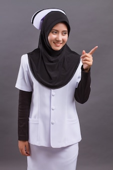 Muslim nurse pointing up finger
