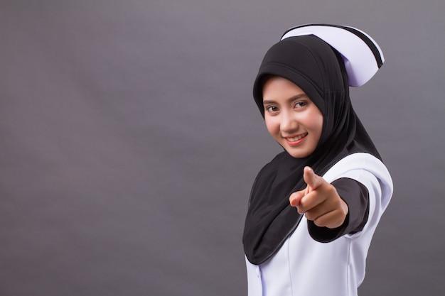 Muslim nurse pointing at you