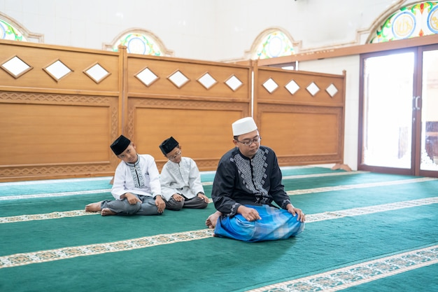 Muslim people praying in the mosque