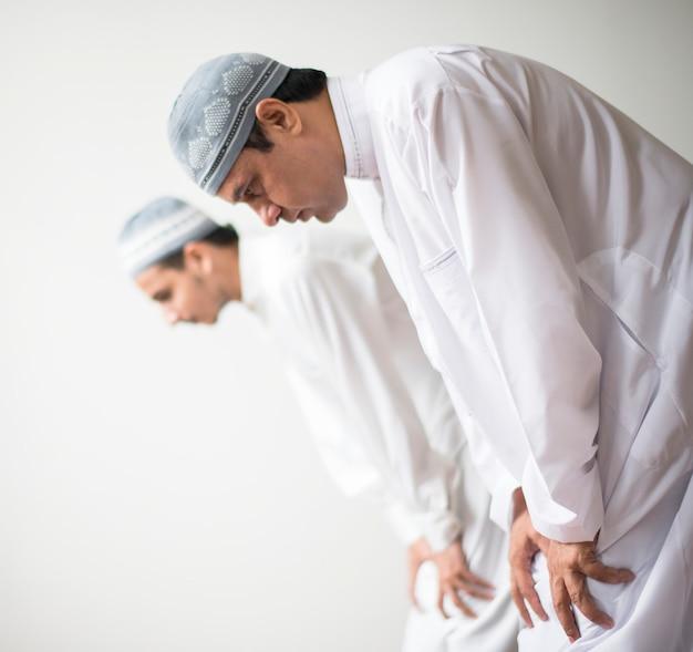 Muslim prayers in ruku posture