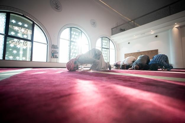 Muslim praying inside beautiful mosque