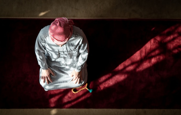 Muslim praying inside beautiful mosque