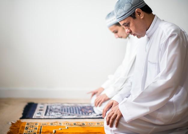Muslim praying in tashahhud posture