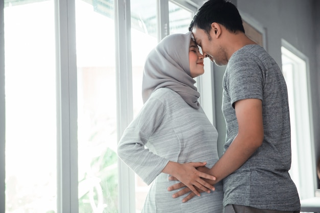 Muslim pregnant woman with her husband