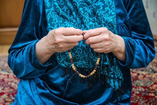 Muslim rosary in the hands of an elderly woman