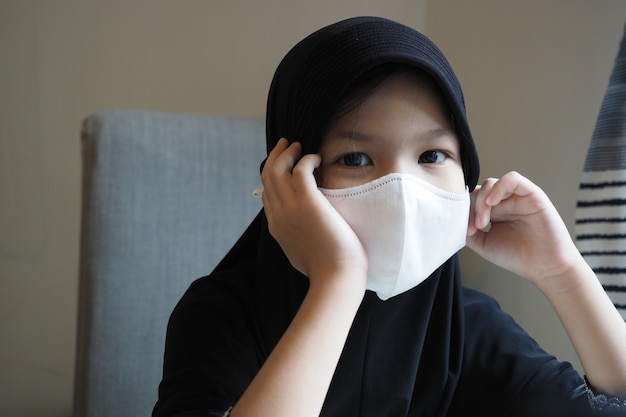 Muslim school kid self isolation,stay home with mask