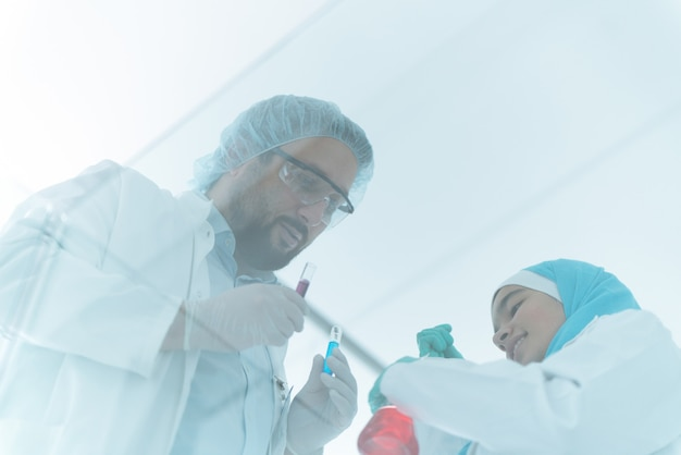 Muslim scientists male and female in hospital lab