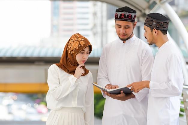 Muslim teen group reading book