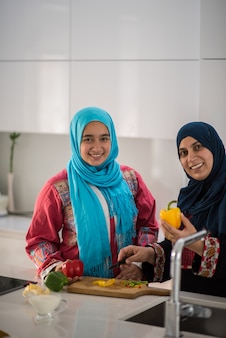 Muslim traditional woman working in kitchen