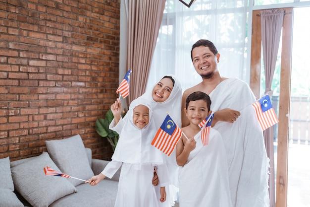 Muslim umrah and hajj with malaysian flag