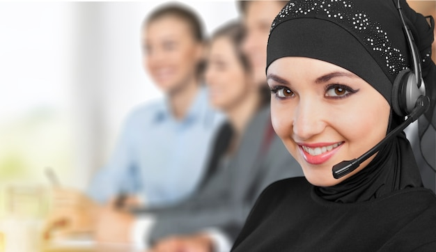 Muslim woman call center operator with headset