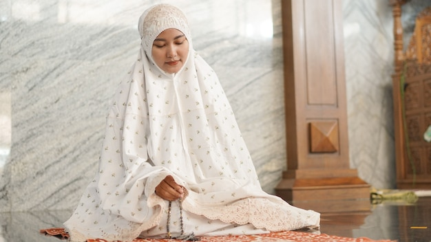 Muslim woman doing dhikr in the mosque