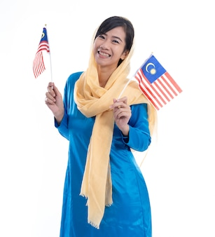 Muslim woman excited holding flag of malaysia