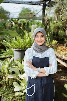 Muslim woman gardener crossed arm