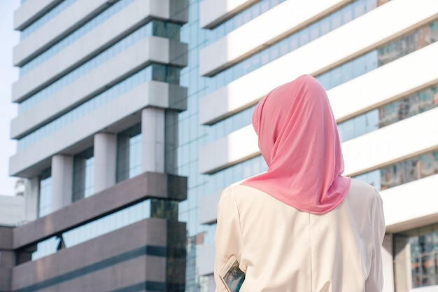 Muslim woman is alone in the city.