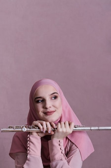 Muslim woman playing on the flute