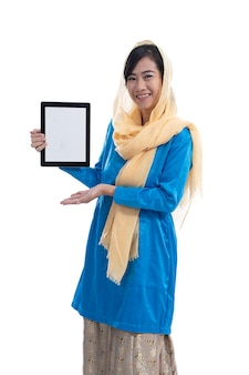 Muslim woman showing her tablet pc screen isolated over white