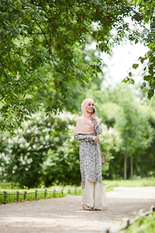 Muslim woman walking in park
