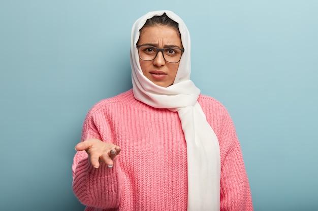Muslim woman wearing pink sweater