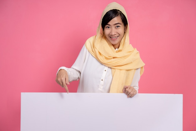 Muslim woman with hijab with blank white board