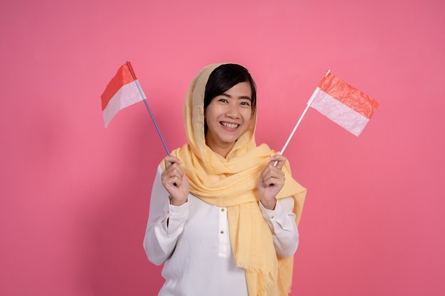 Muslim woman with indonesia national flag