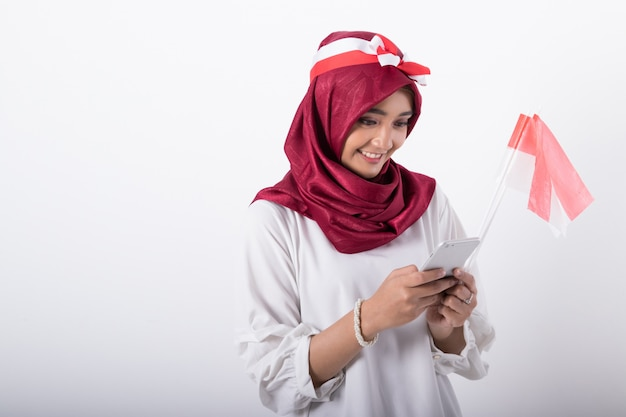 Muslim woman with indonesian flags