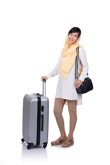Muslim woman with suitcase