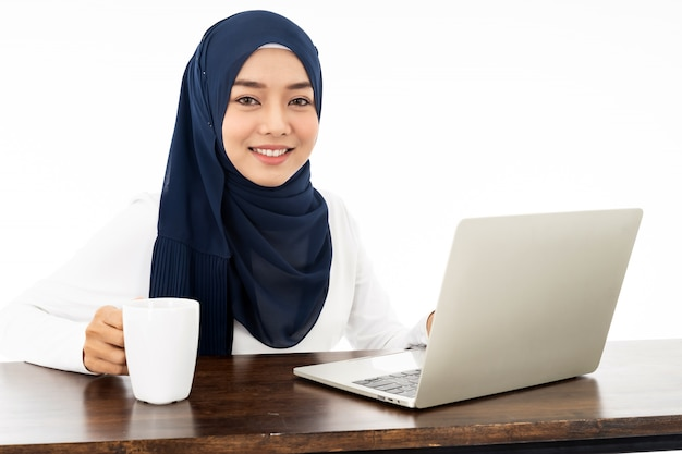 Muslim woman working from home