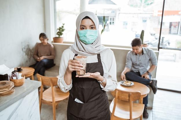 Muslim worker wearing masks while working