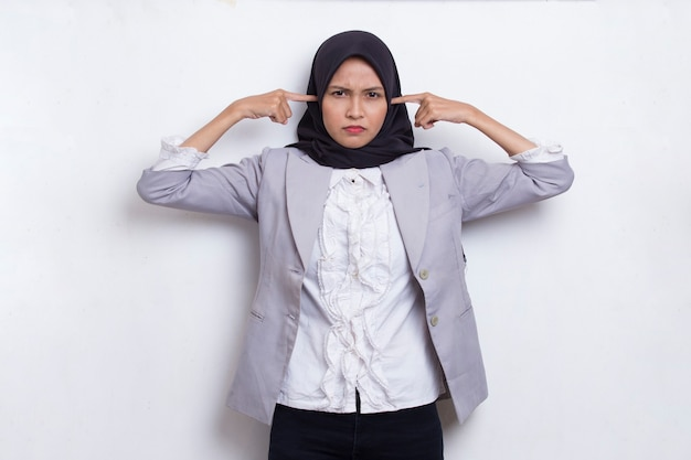 Muslim young asian woman a covers her ears