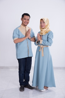 Muslim young couple greeting
