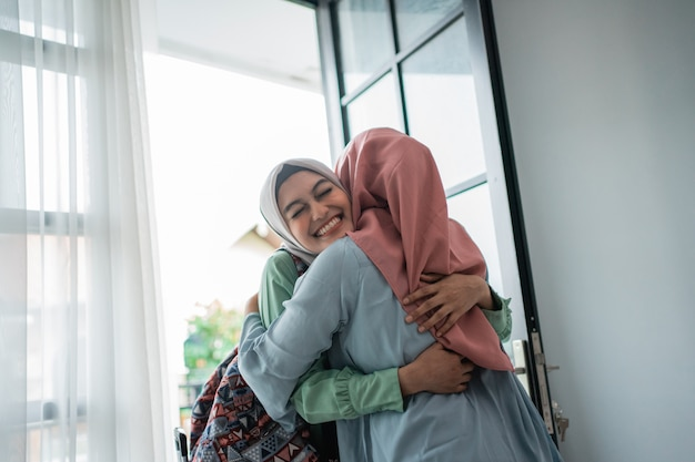 Muslim young woman enthusiastic about meeting her mother