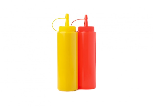 Mustard and ketchup bottle isolated on white surface