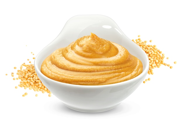 Mustard sauce and seeds isolated on white