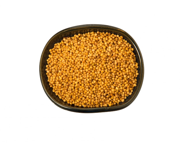 Mustard seeds in a bowl on a white background.