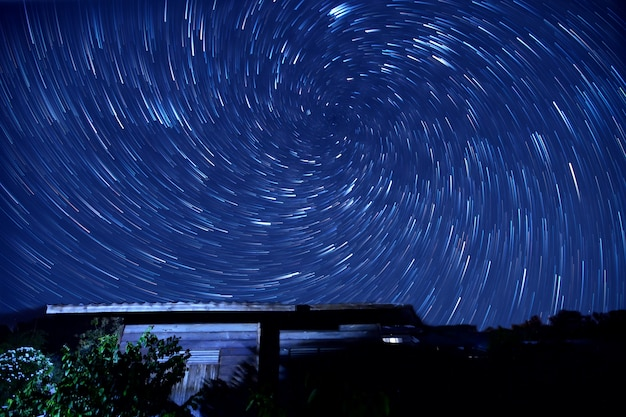 My home a vortex spiral star trail in the sky